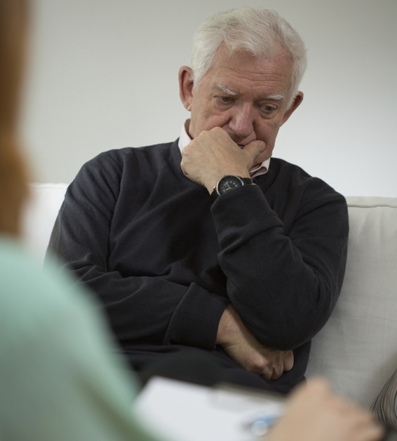 Senior man with depression during visit in psychiatrist